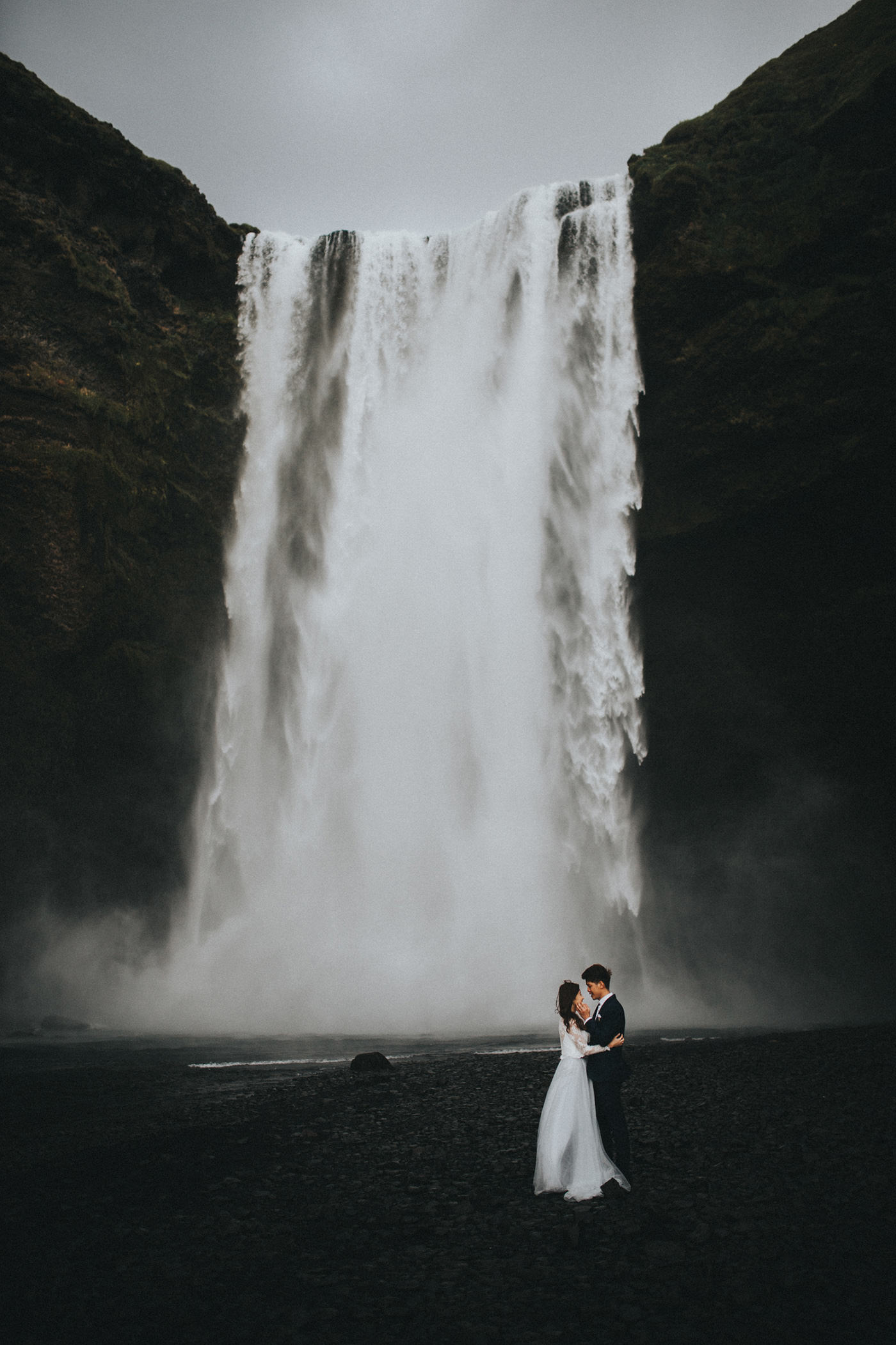 Skogafoss waterfall elopement Iceland wedding couple photographer